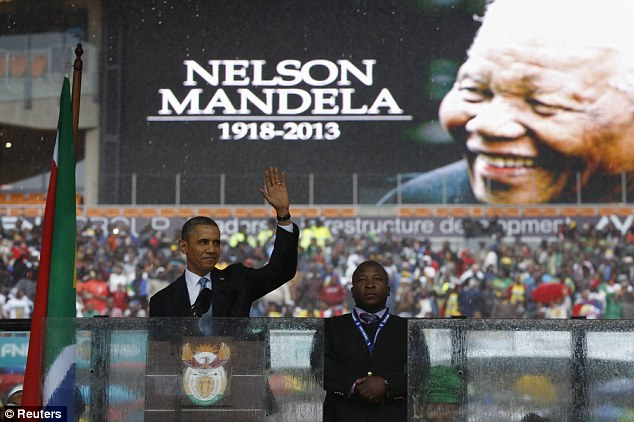 Eulogy: U.S. President Barack Obama acknowledges the crowd as he delivers his speech at the memorial service for Nelson Mandela in Johannesburg