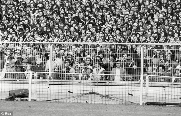 Days gone by: Crowds packed into Wembley when standing was permitted in football grounds