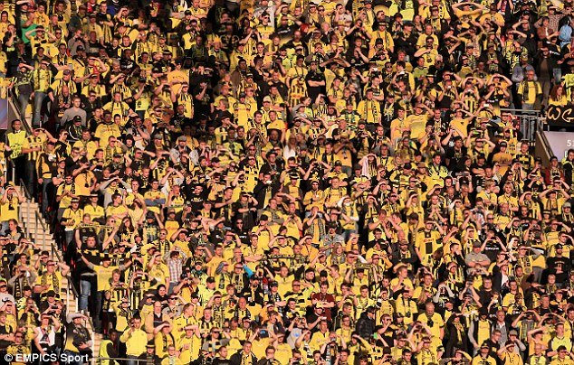 Stand and deliver: Borussia Dortmund fans are able to stand for domestic games at the Westfalenstadion