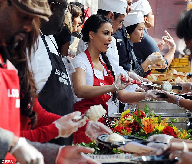 'I will continue to do what is in my heart': The generous 33-year-old not only donates 10 per cent of her monthly eBay auction profits but the same amount of every endorsement deal - seen here volunteering with the homeless on Thanksgiving 2011