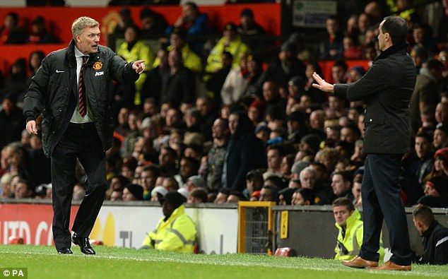 Passing the baton: Martinez (right) is continuing predecessor David Moyes' (left) good work with Everton