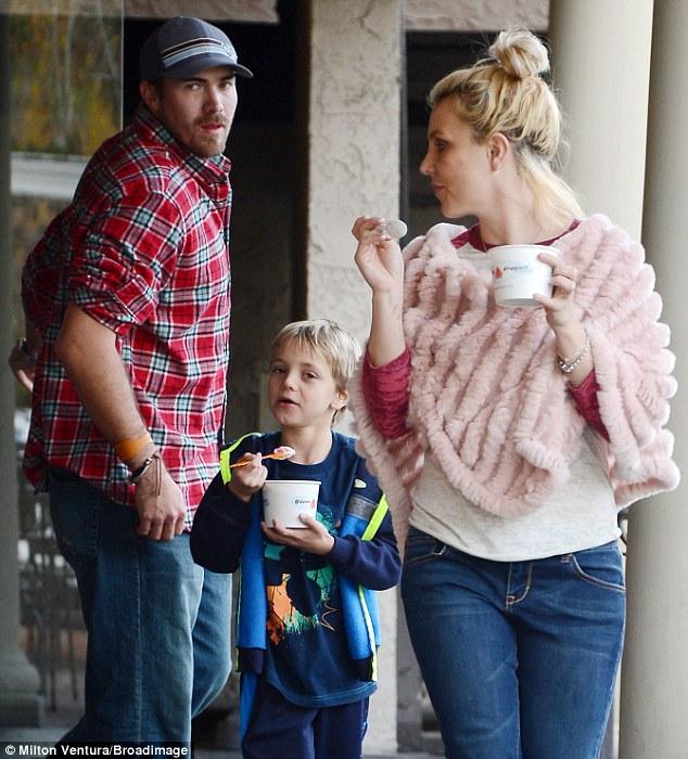 A rare break: The 32-year-old enjoyed frozen yogurt with boyfriend David Lucado and son Sean on Saturday