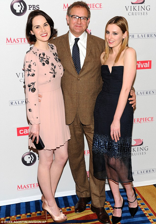 Daddy cool: Hugh Bonneville looked like he was having a great time with on-screen daughters Michelle Dockery and Laura Carmichael in New York on Tuesday