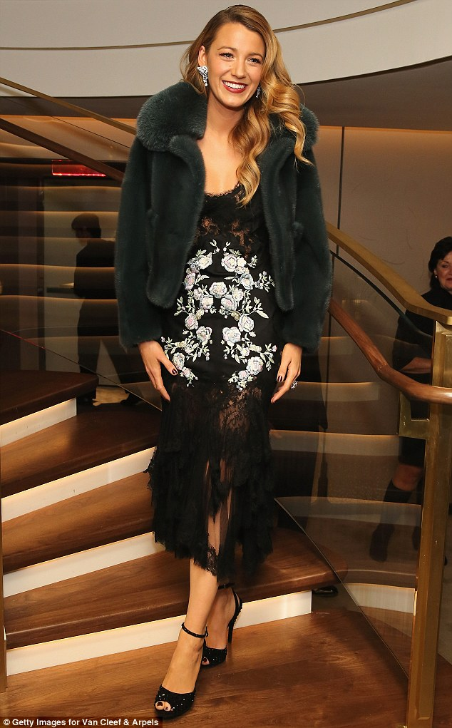 Grand entrance: The Savages star wore a vintage-style fur jacket as she made her grand entrance down the set of stairs to the store