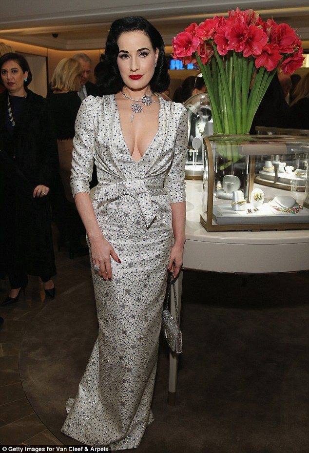 Jaws dropped: Meanwhile, as always, Dita easily stole the show on the night, with the burlesque beauty wowing the well-heeled crowd in a plunging off-white silk gown that revealed some considerable cleavage
