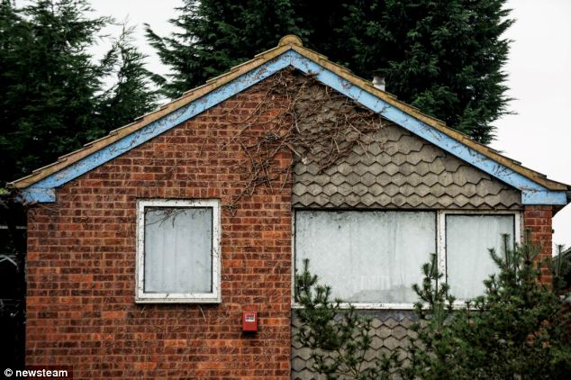 Then first floor windows in the house are now visible after the plant growth was trimmed this year