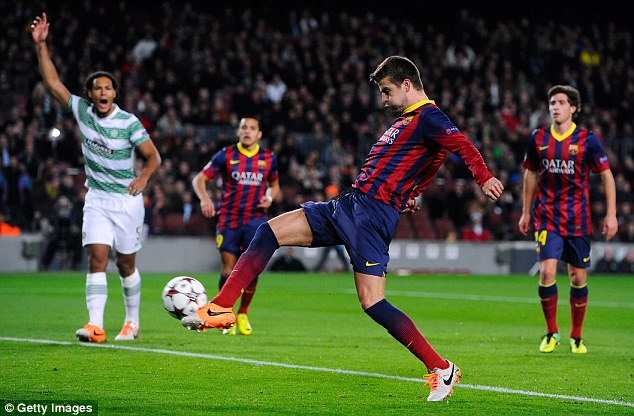 Opener: Barcelona's Gerard Pique scores the first goal after seven minutes