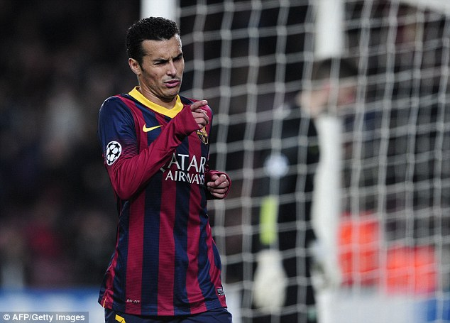 All too easy: Barcelona forward Pedro Rodriguez points to the crowd after putting the home side 2-0 up