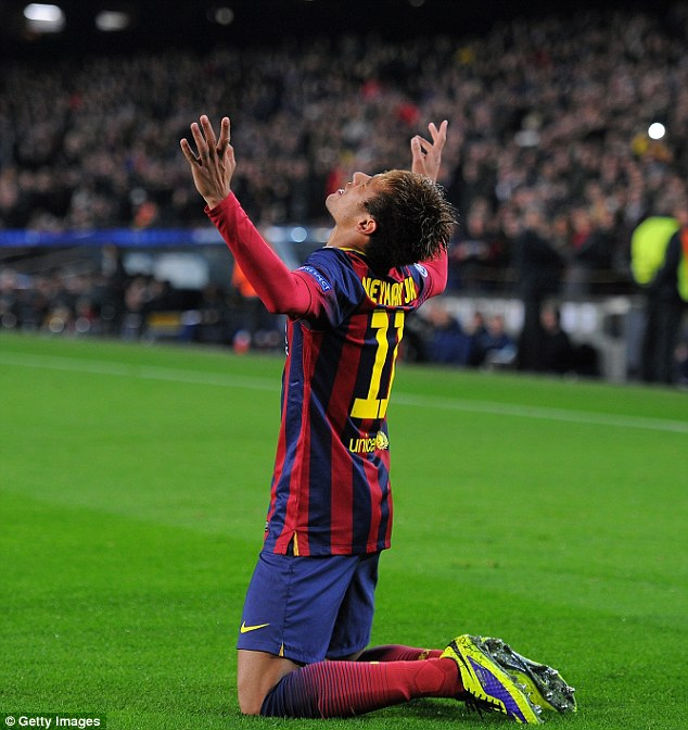 Unstoppable: Neymar looks to the sky as he celebrates completing his hat trick