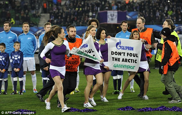 Having their say: Greenpeace activists demonstrate prior to kick off in Vienna