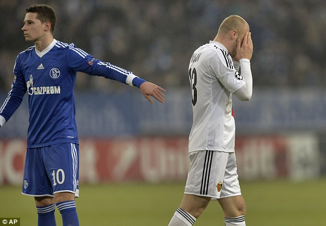 Marching orders: Basel's Ivan Ivanov (right) puts his hands on his face after he received a red card for a foul on Schalke's Adam Szalai