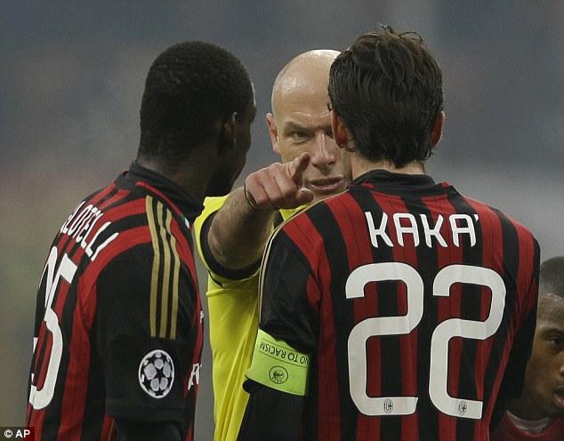 Go away! British referee Howard Webb gestures to AC Milan forward Mario Balotelli (left) (Kaka) during a Champions League, Group H, match between AC Milan and Ajax at the San Siro stadium