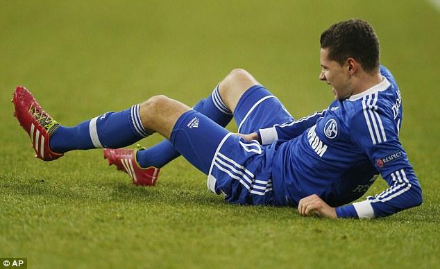 Injured: Schalke's Julian Draxler holds his groin