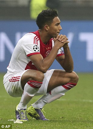 Ajax forward Danny Hoesen reacts at the end of a Champions League, Group H, soccer match between AC Milan and Ajax at the San Siro stadium in Milan, Italy