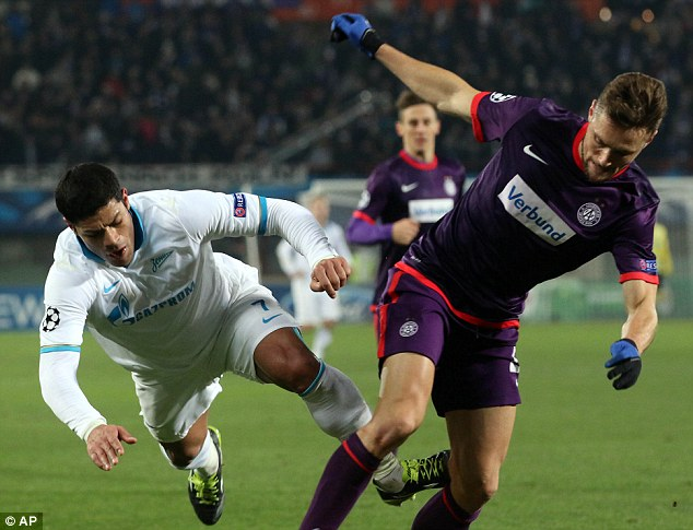 Taking a tumble: Hulk (left) of Zenit  St Petersburg attempts to stop James Holland (right)