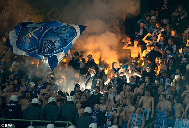Flying the flag: Zenit fans fly the club flag as trouble erupted in the stands