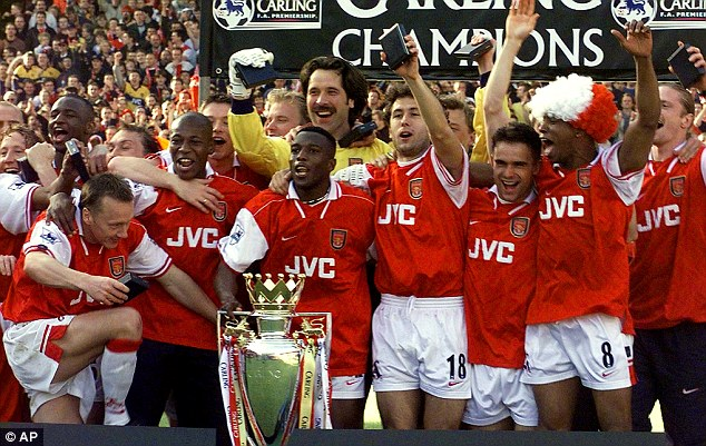 Champions: Arsenal went on to win the double in Wenger's first season - including the Premier League