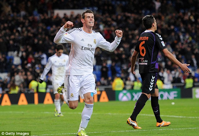 Enter the Dragon: Gareth Bale (left) is flying after a slow start to his career in Spain