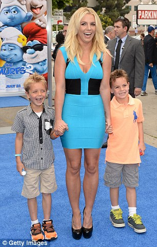 Fatherly love: Kevin is also father to two sons with ex wife Britney Spears (L) and a boy and a girl with former partner Shar Jackson (R)