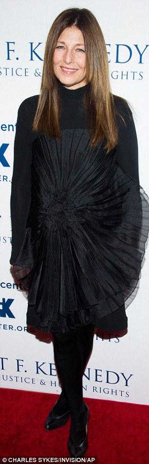 Chic ladies: Julianne Margulies looked the height of style in a fitted black-and-white dress while Catherine Keener took a risque with an embellished black frock