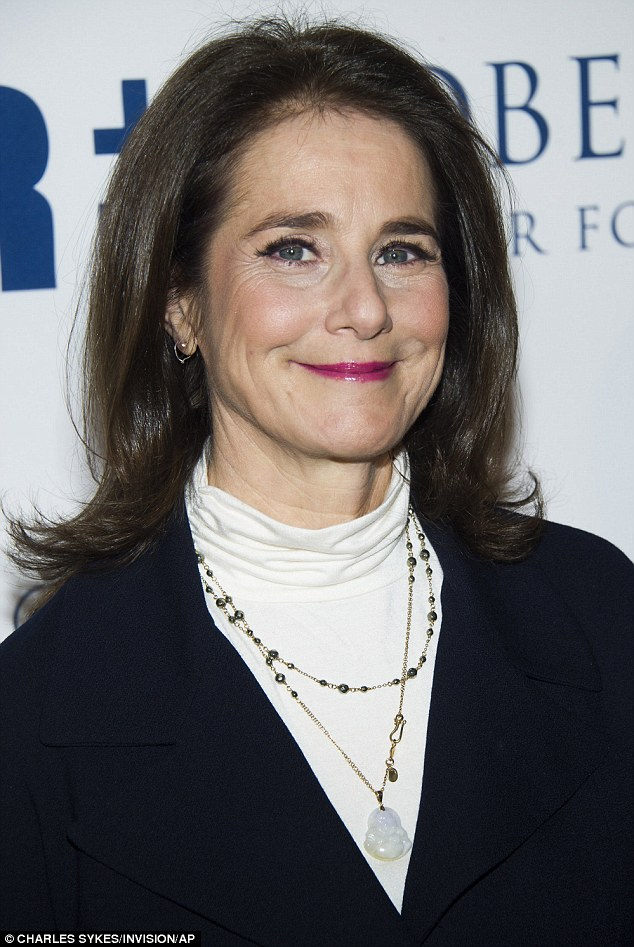 As gorgeous as ever: The 58-year-old wore her brown hair in a sleek style and added colour with fuchsia lipstick