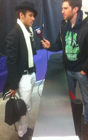 Daring dresser: Neymar was wearing an eye-catching outfit for his post-match interviews