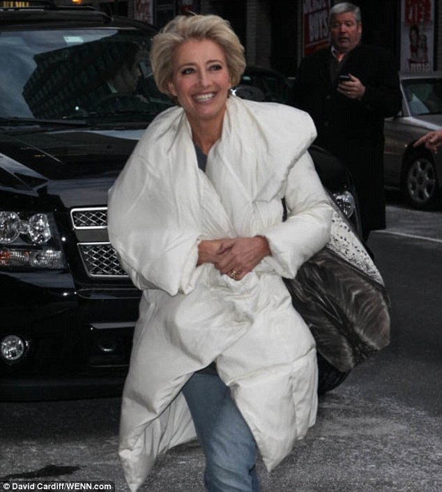 Getting poofy: The 54-year-old wore a large snow jacket reminiscent of a comforter for the chilly day
