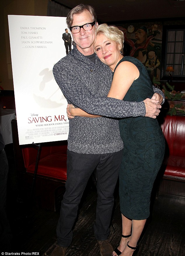 Hugging it out: Emma embraced John Lee Hancock at the event