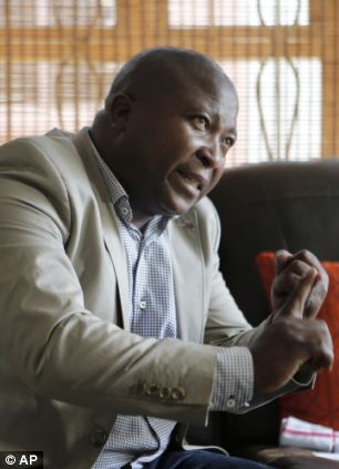 Thamsanqa Jantjie gestures at his home
