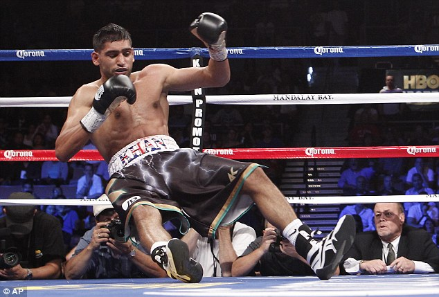 Down and out: Khan was knocked down and eventually stopped by Danny Garcia last year