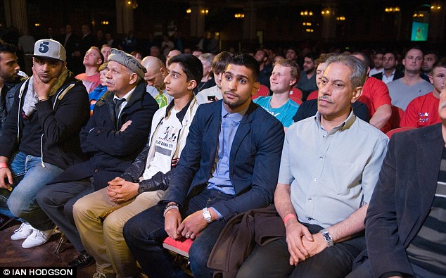 Waiting game: Khan (centre) has not fought since April as he waits for his big date in Vegas to be confirmed