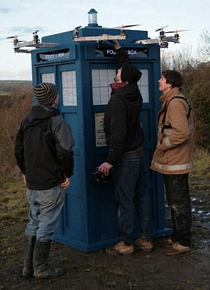 Ready for lift off: The flying full-sized Tardis is given a final check by the team before taking to the sky