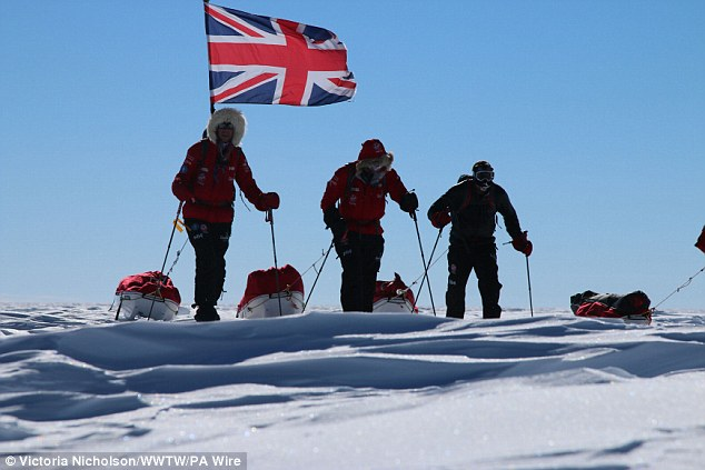 Happy: Prince Harry said spirits are high after the decision to suspend the competitive element of the trek