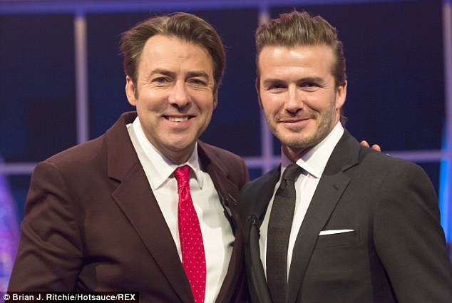 Smile for the camera: David Beckham (right) appears on Saturday's Jonathan Ross Show on ITV