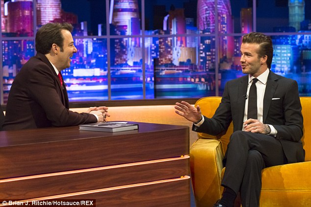 Smooth talker: Beckham sits on the sofa as he is interviewed by Ross on his weekly chat show