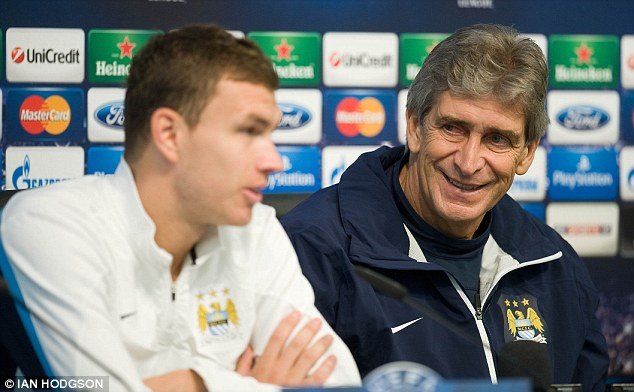 Staying put: Pellegrini has previously insisted Dzeko will not leave the Etihad in the near future