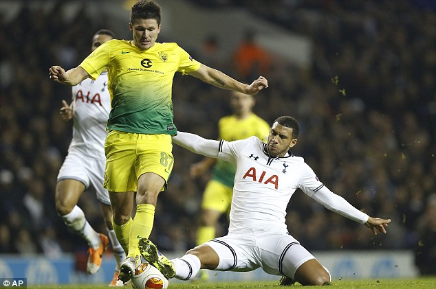 All mine: Tottenham's Etienne Capoue vies for the ball with Anzhi's Ilya Maksimov
