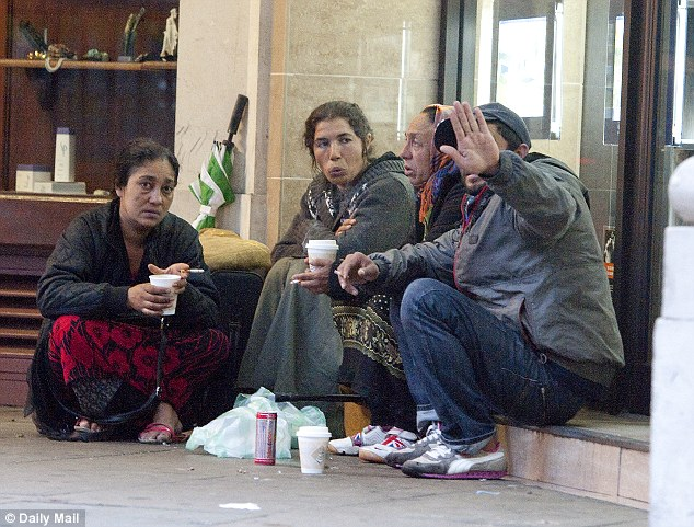 Homeless Romanians congregate on Park Lane in London: The police has been told to investigate why the latest arrest figures are so disproportionate
