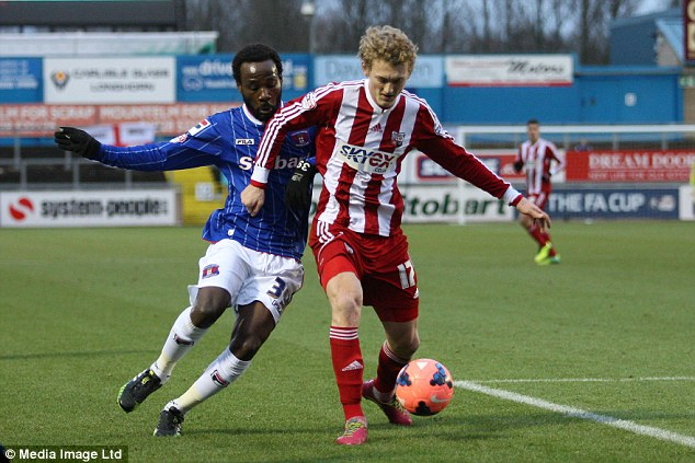 Rising star: George Saville (right) currently plays on loan from Chelsea at Brentford