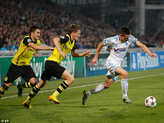 Highly rated: Marseille's Florian Thauvin (right) was watched by Chelsea's Jose Mourinho