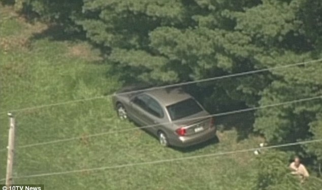 Crime scene: Ballman's body was found in her car, pictured, in a wooded area near New Albany in 2012