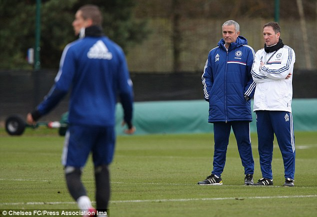Goal shy: Jose Mourinho watches over Fernando Torres during a training session at Cobham