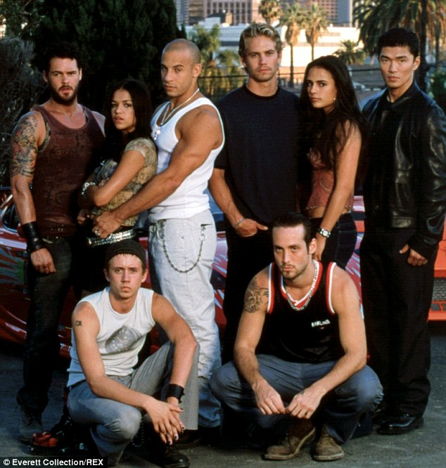 An integral part of the action: Paul, seen here in a 2001 shot with his The Fast & The Furious castmates, starred in five of the six films in the franchise, while he was halfway through shooting the seventh instalment when he tragically died in a car crash right out of the films' script