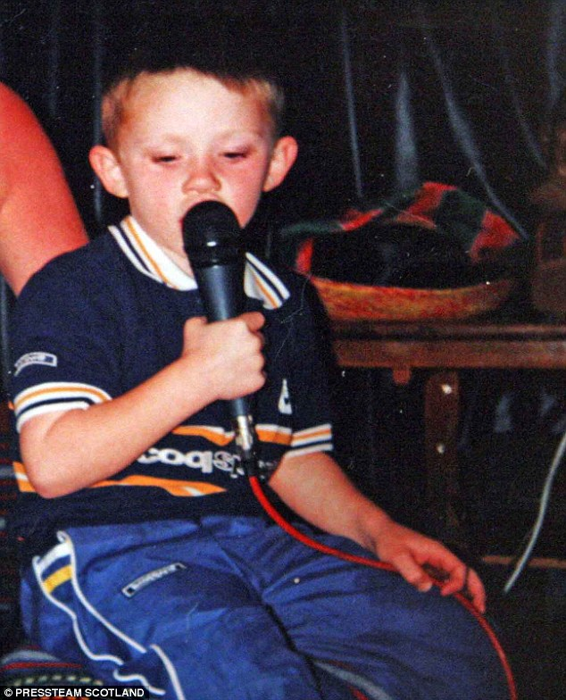 Always performance ready! Nicholas was already behind the microphone when he was just four-years-old