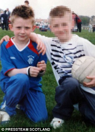 Playful: As a seven-year-old he loved nothing more than a kick about in the park