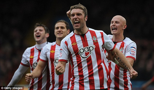 Saint: Lambert (centre) has made 178 appearances for Southampton since signing in 2009