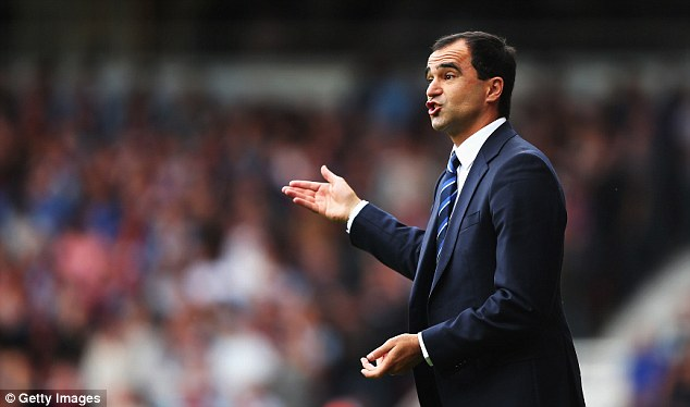 Top boss: Coleman believes the Everton team are relishing playing under Roberto Martinez (above)