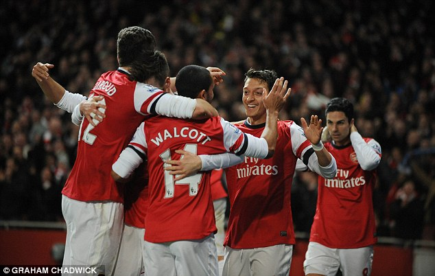 Team spirit: The Gunners will have to maximize the potential of their squad to get points against Manchester City and Chelsea over the next two games