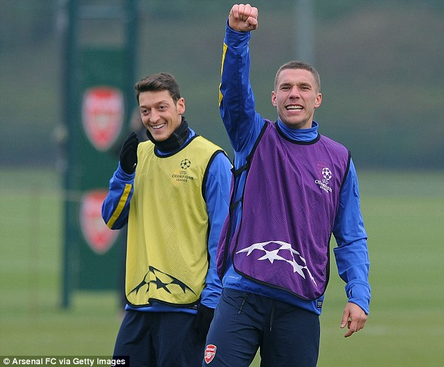 Superman: Podolski, who has yet to return to action from an August injury, says there is no reason why Arsenal shouldn't believe they can't pull off a title win
