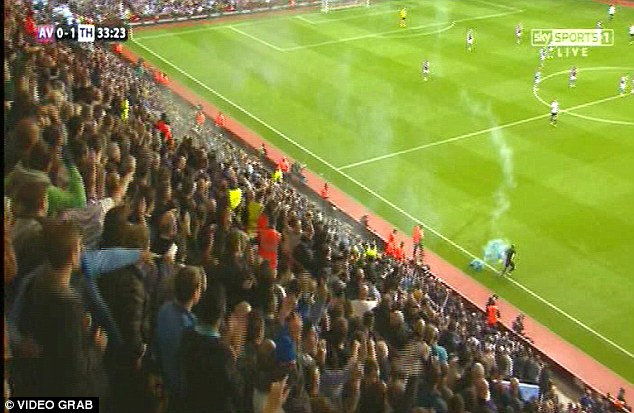 Struck: A linesman was hit on the shoulder by a flare during Aston Villa's match with Spurs earlier this season